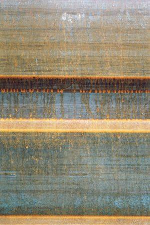 Fotografía de valla metálica oxidada
